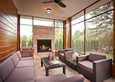 Modern sunroom with stone fireplace