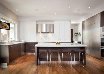Modern kitchen with stainless steel fridge
