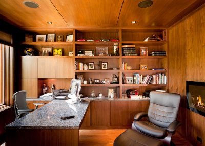 Home office with wood paneling