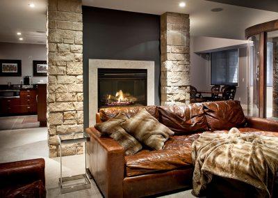 Basement stone fireplace tv room