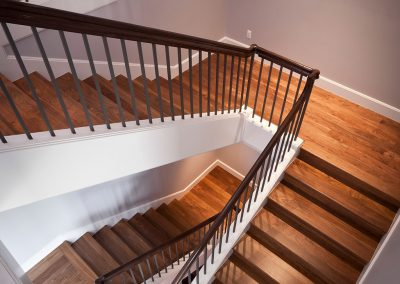 Modern staircase with iron spindles
