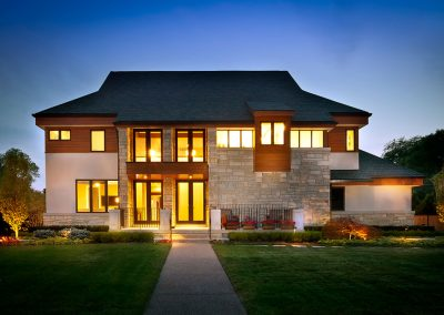 Modern new build home with Fon Du Lac stone and Cypress wood and EIFS siding