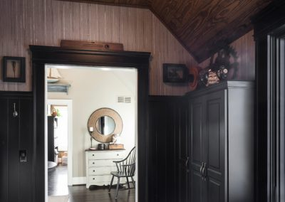 Mudroom with black custom cabinetry and wood ceiling detail
