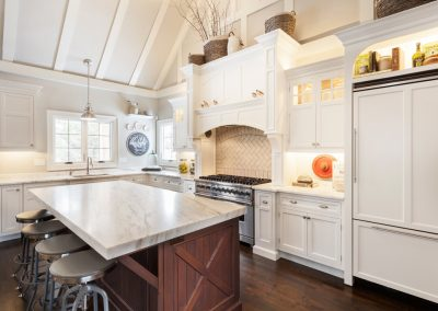 Transitional white kitchen renovation with Danby marble countertops