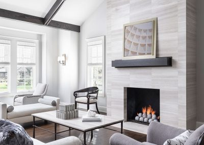 Living room with marble fireplace and wood beams