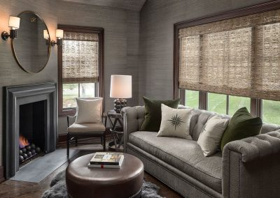 Den with fireplace and grass cloth wallpaper