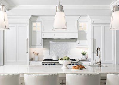 White kitchen with Visual Comfort lighting