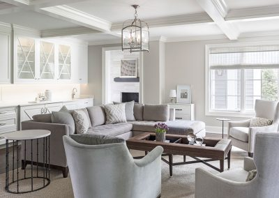 family room with custom cabinet bar and coffered ceiling