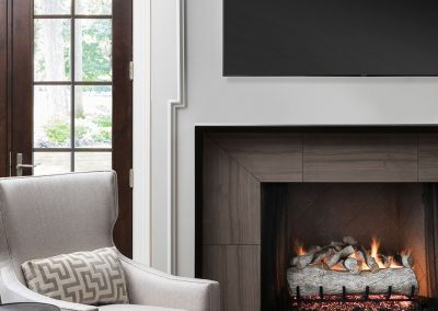 Traditional family room with marble tile fireplace surround