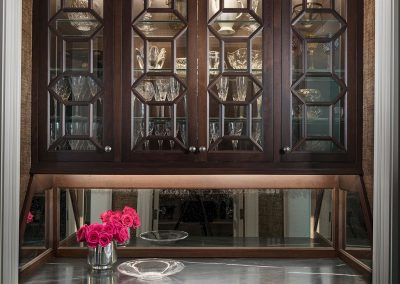 Bar with custom cabinets and grass cloth ceiling