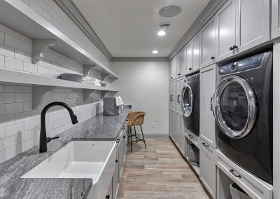 Laundry room with floating shelves
