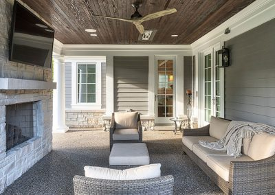 Outdoor living space with fireplace and infrared heaters