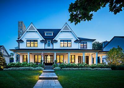 Modern farmhouse with blue stone wrap around porch