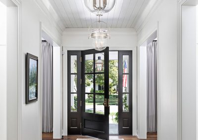 foyer with shiplap on ceiling