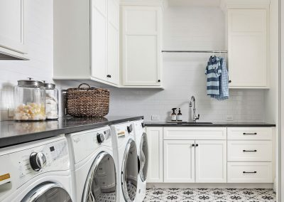 Laundry room with ceramic tile