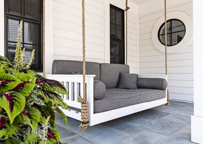 Blue stone front porch with swing
