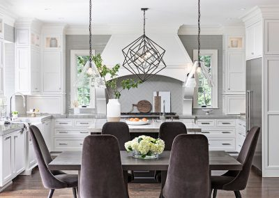 White transitional kitchen with dining table