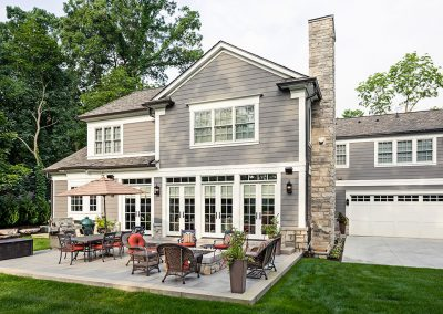 Traditional new build exterior with stone fireplace