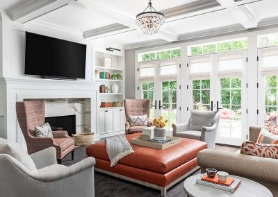 Transitional family room with custom built-ins and coffered ceiling