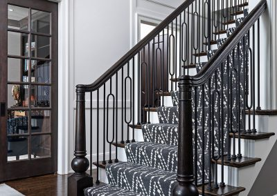 Transitional foyer with with iron spindles