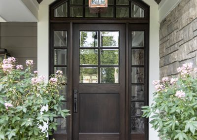 Traditional new build front door with gas lantern