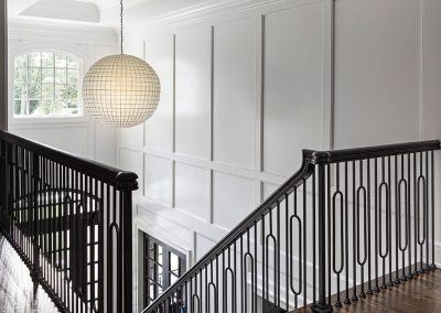Transitional new home foyer with raised paneling and tray ceiling